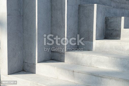 Abstract background - play of light on concrete stairs.