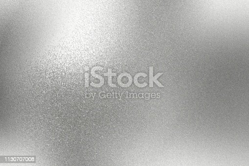 istock Abstract background, reflection rough chrome metal texture 1130707008