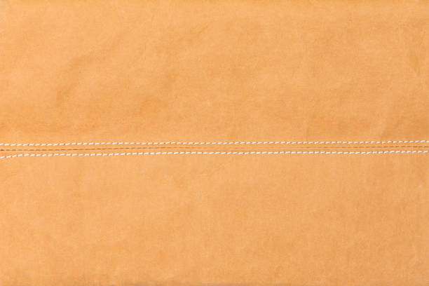 abstract background, stitches on paper bag, copy space - seam stock photos and pictures