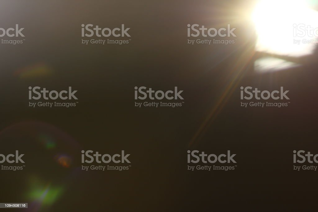 Abstract background. Sun Rays on black background. Flare with rays.
