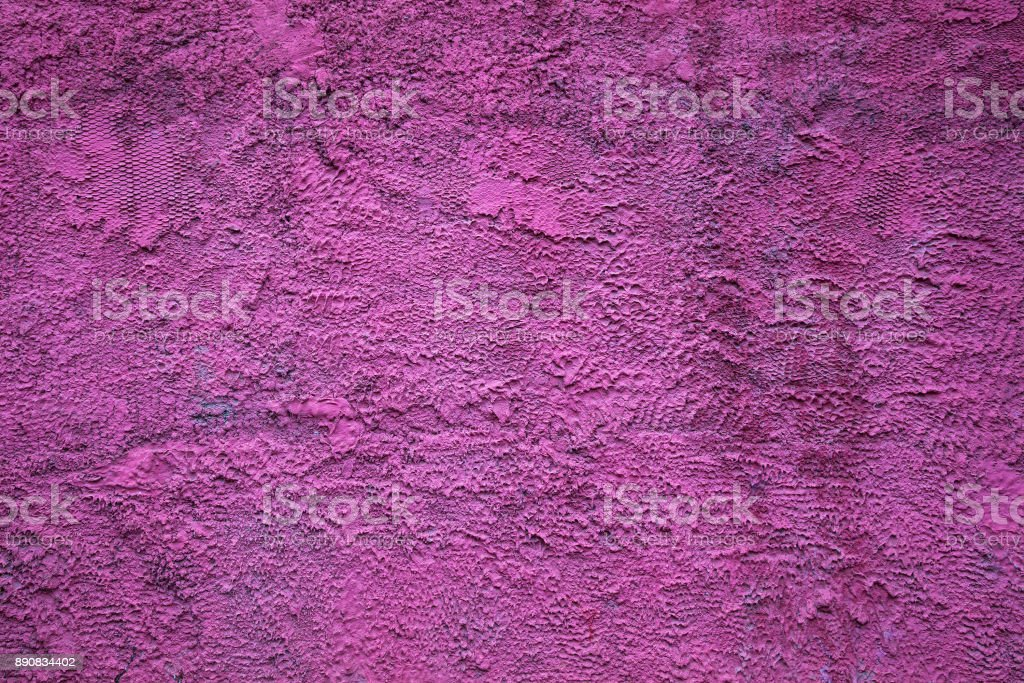 Abstract background texture of a rough concrete wall bright purple color. The rough blank surface stock photo