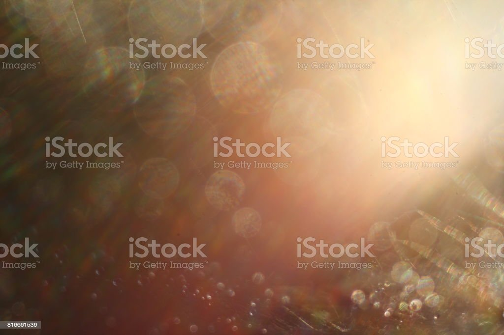 Abstract background. Water droplets on a spider web. Selective focus. Light transition, lens flare, light leaks, Sun rays, bokeh. stock photo