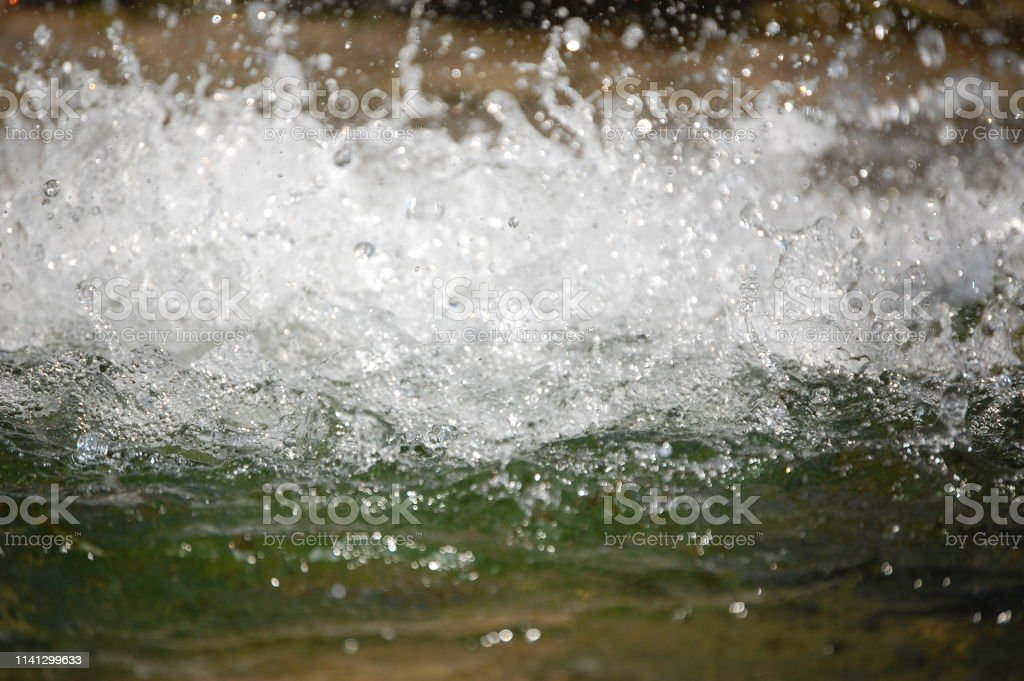 abstract background - water flows in the river. photo stream of...