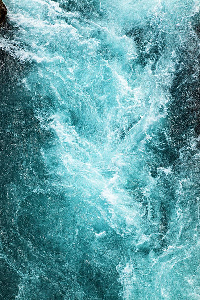 abstract background - water flows in the river - flowing water stock photos and pictures