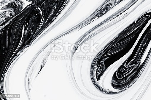istock abstract background, white and black mineral oil paint on water 679554364