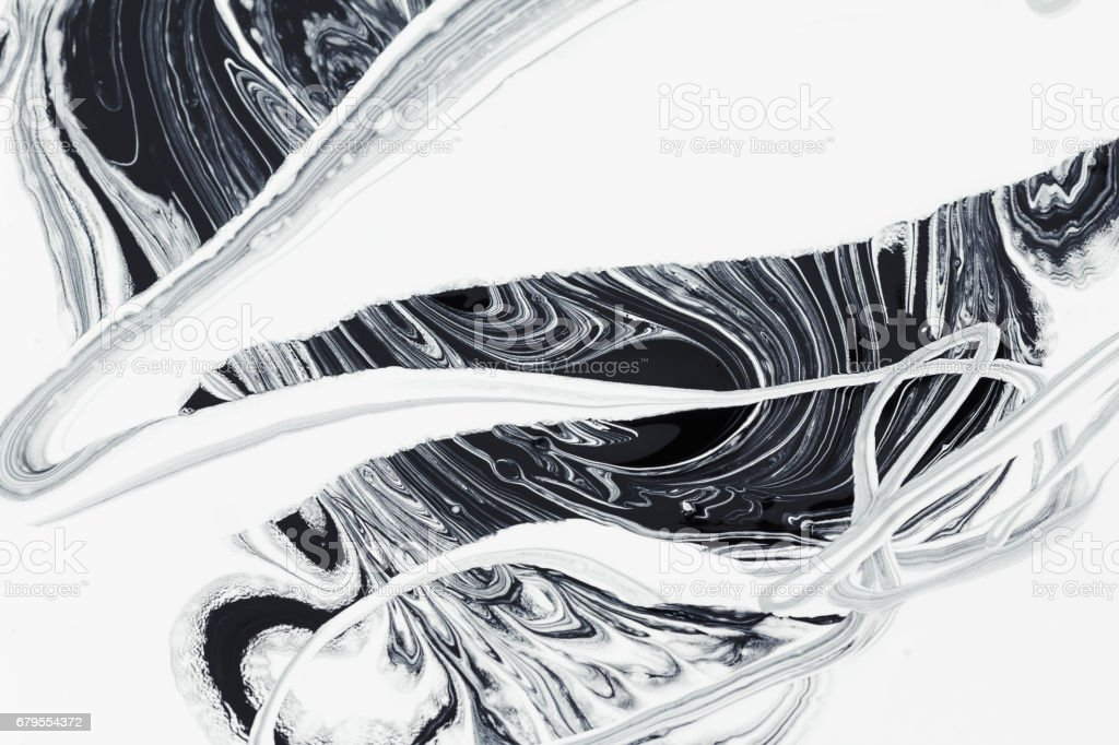 abstract background, white and black mineral oil paint on water stock photo