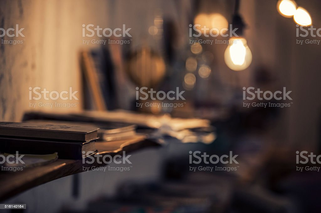 Abstract background with a lamp and book shelves stock photo