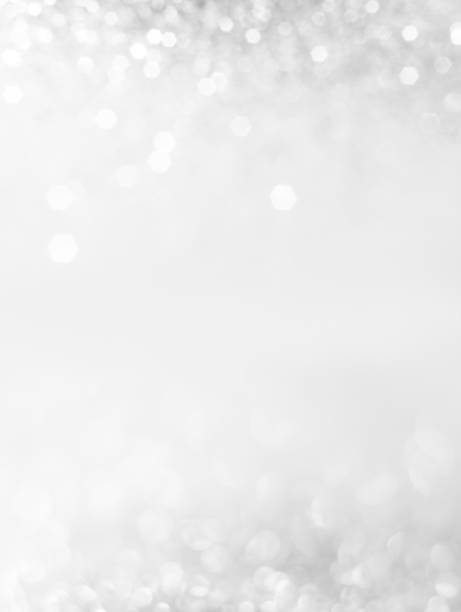 abstract background with a white light blur - silver colored stock pictures, royalty-free photos & images