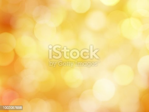 Abstract Soft Glowing Golden Yellow Background with Bokeh Lights