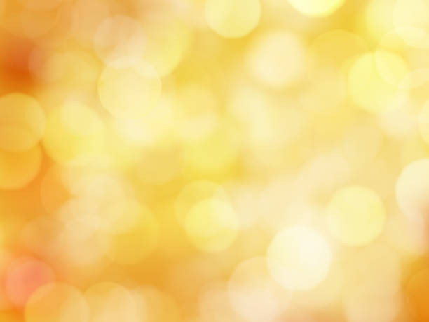 Abstract Background with Bokeh Lights Abstract Soft Glowing Golden Yellow Background with Bokeh Lights autumn leaf color stock pictures, royalty-free photos & images