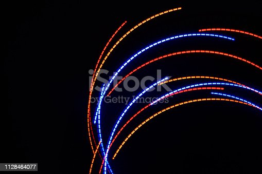 96824512istockphoto Abstract background with color lights 1128464077
