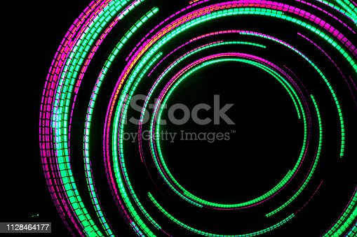 96824512istockphoto Abstract background with color lights 1128464177