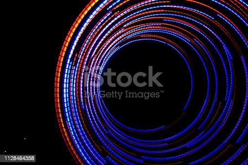 96824512istockphoto Abstract background with color lights 1128464358