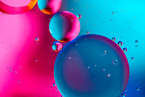 Abstract background with colorful pink blue gradient colors. Oil drops in water abstract psychedelic pattern image
