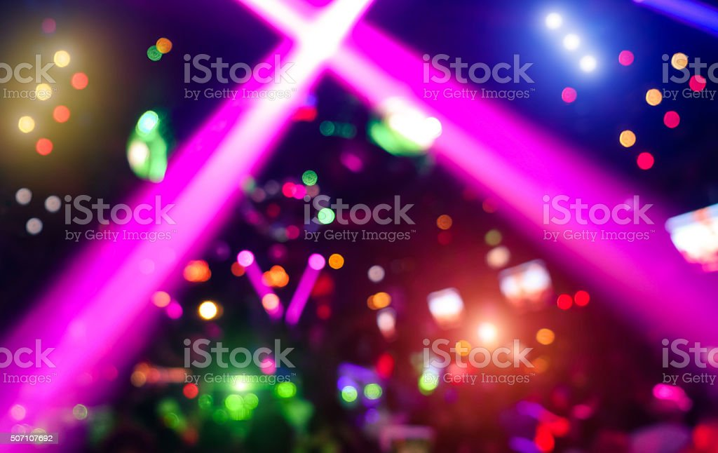 Abstract background with defocused bokeh laser show in modern nightclub stock photo