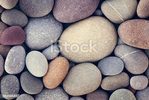 istock abstract background with dry round pebble stones macro 584594442