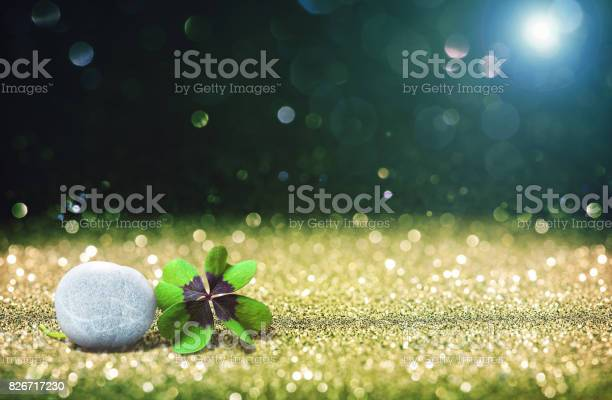 Abstract background with four leaf lucky clover and stone picture id826717230?b=1&k=6&m=826717230&s=612x612&h=p8ozw4pwmhoprqwgq8 z1vxxy2ets2amtzfjoxc1xjc=