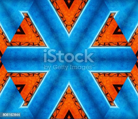istock Abstract background with geometric kaleidoscopic design with predominant blue and orange colors 806162844