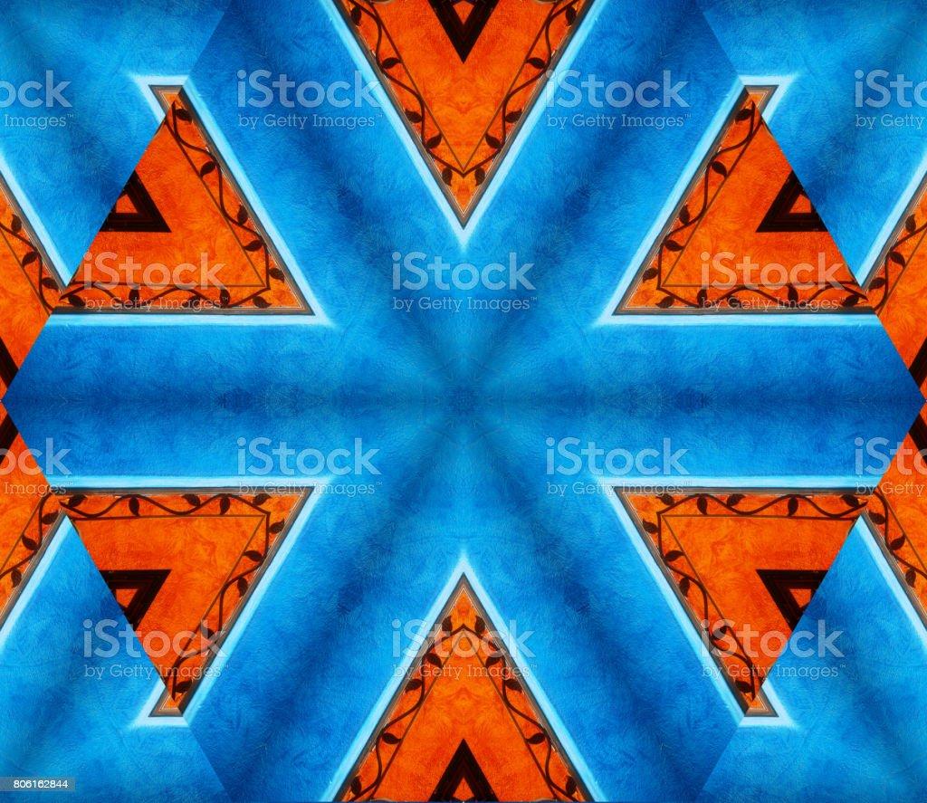Fondo abstracto con diseño geométrico caleidoscópica con colores azul y naranja predominantes - foto de stock