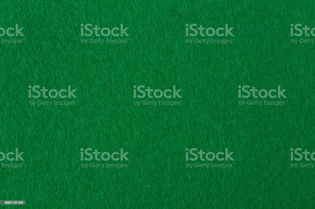 Abstract background with green felt texture stock photo