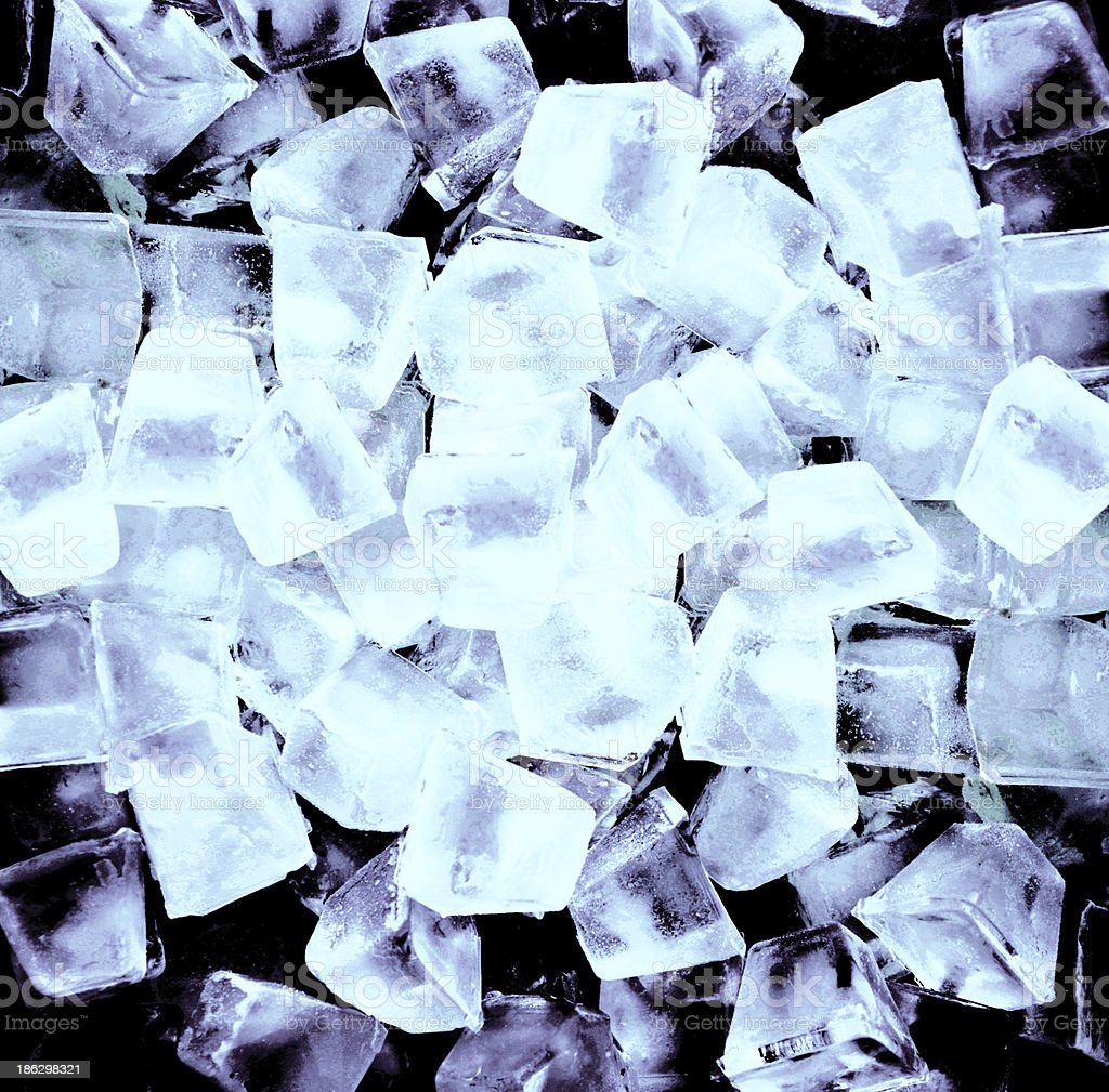 Abstract background with ice cubes in black light royalty-free stock photo