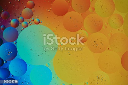Abstract Background with orange and blue Bubbles in Water. Macro photography. Top view.