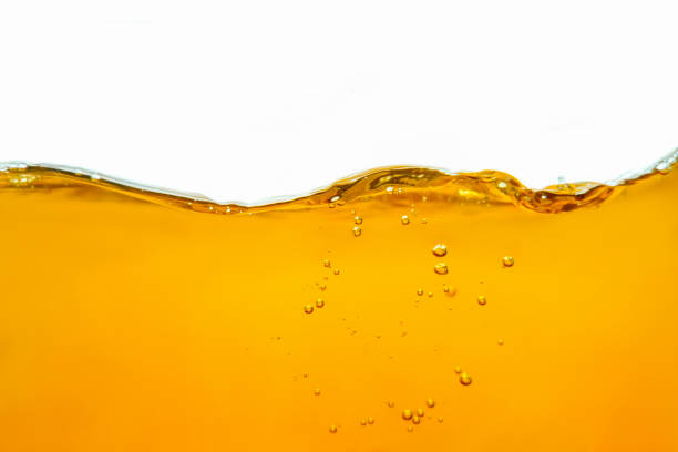 Abstract background with splashes, sprays, waves, bubbles of lager beer, whiskey, cognac, rum, brandy. stock photo