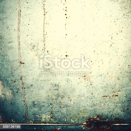 1207526097 istock photo Abstract  background with spotlight and scratches. Dark grunge 539139195
