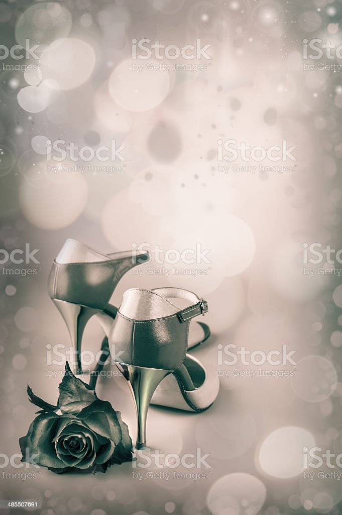 Abstract  background with tango shoes and a rose stock photo