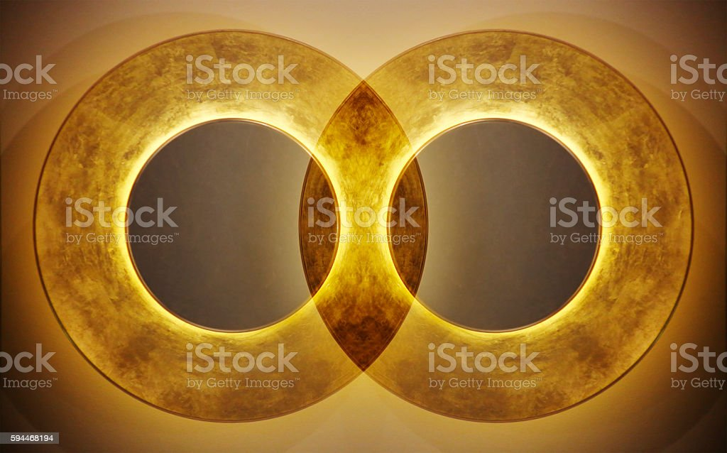 Abstract background with two interweaving luminous rings. Union of sets. stock photo