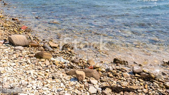 Abstract beach background texture with pebbles, sands and sea water in bodrum turkey