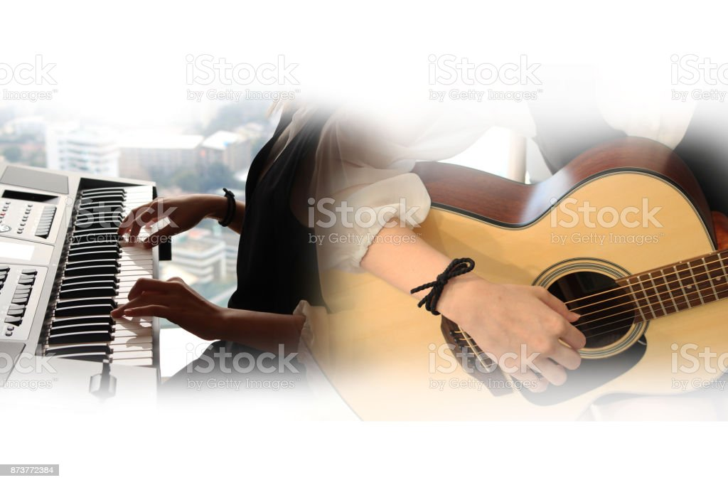 Abstract beautiful playing acoustic guitar and piano on Watercolor painting background and Digital illustration brush to art. stock photo