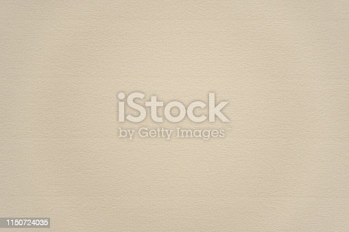947207308istockphoto Abstract beige paper texture background 1150724035