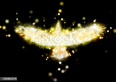 645448998 istock photo Abstract bird shining in golden light with spread wings 1250902375