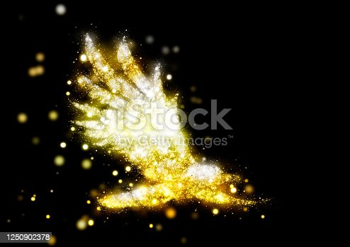 645448998 istock photo Abstract bird shining in golden light with spread wings 1250902378