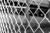 istock Abstract black and white background of metal wire fence 479994644