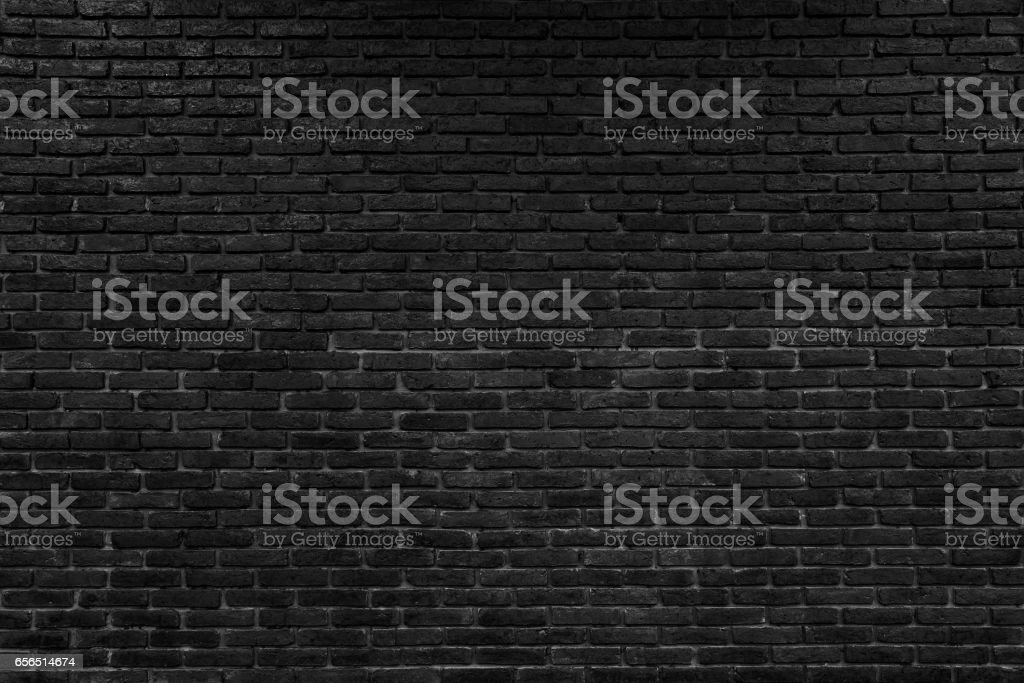 abstract black brick wall pattern background stock photo