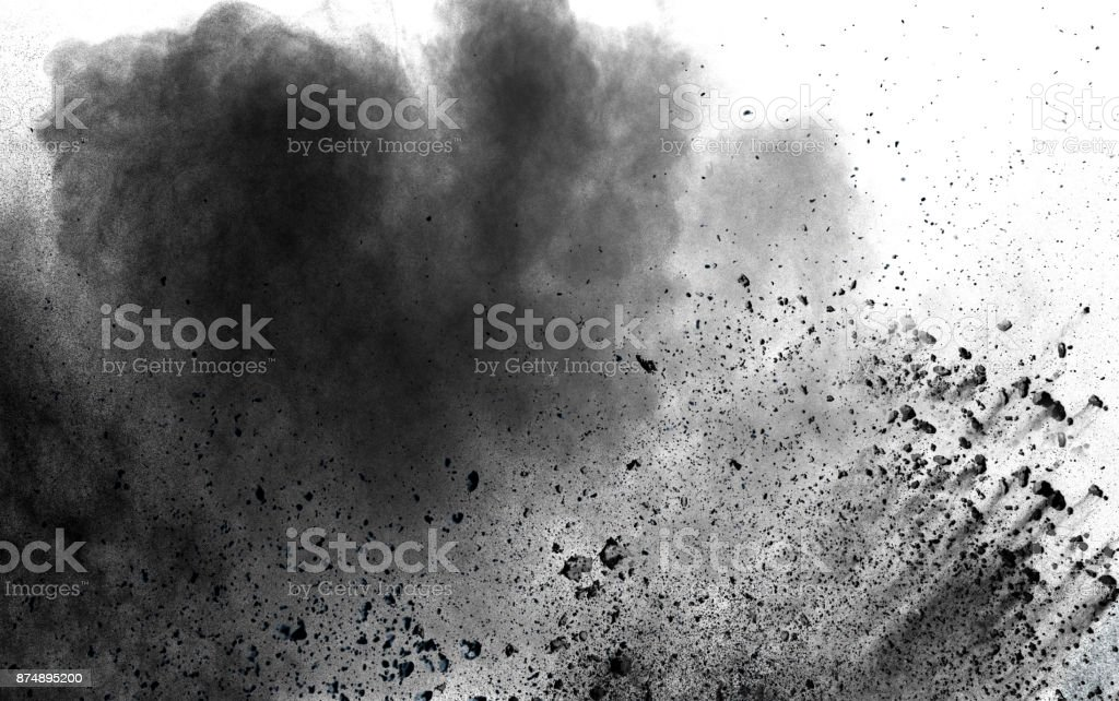 abstract black dust explosion on white background. stock photo