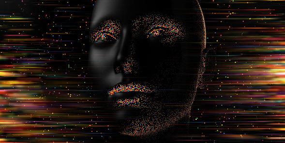 An abstract image. of a black head covered in hundreds of small multi-coloured metallic, shiny spheres around the eyes, noses, lips and jawline. The background consists of multi-coloured spheres and bright streaks. The face peacefully looks off-camera, into the distance.