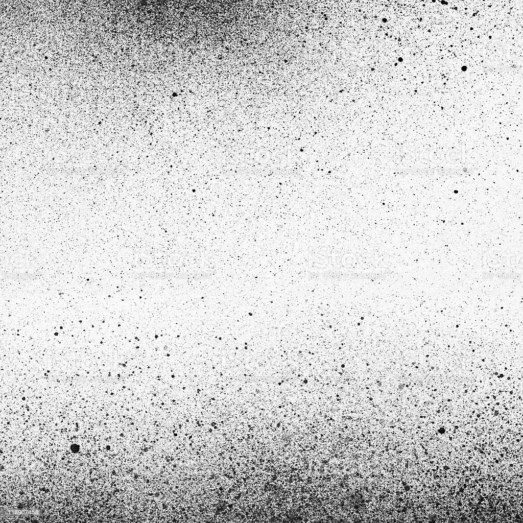 Abstract black paint splatters on a white page stock photo