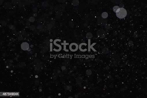 istock Abstract black white snow texture on black background for overlay 487349044