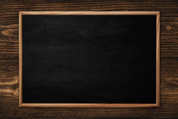 Ahşap arka planda çerçeve ile soyut tahta veya kara tahta. stok fotoğrafı