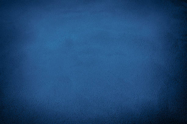 Abstract blue background Close up on cement wall surface. Color conversion and vignetting effect made with Photoshop. dark blue stock pictures, royalty-free photos & images