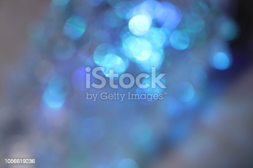 653331540 istock photo Abstract blue bokeh background 1056619236