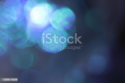 653331540 istock photo Abstract blue bokeh background 1056619358