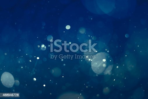 istock abstract blue bokeh background 488946728
