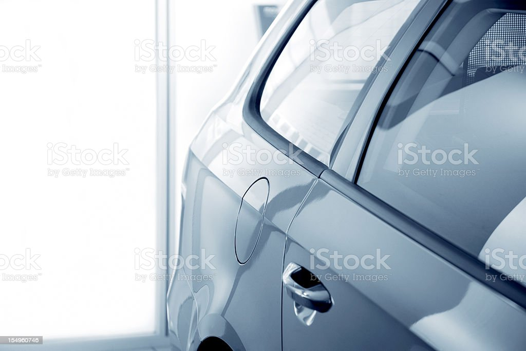 abstract blue car at dealership stock photo