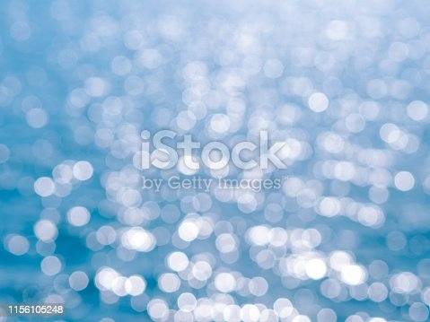 653331540 istock photo Abstract blue circles bokeh from nature for Christmas of any background 1156105248