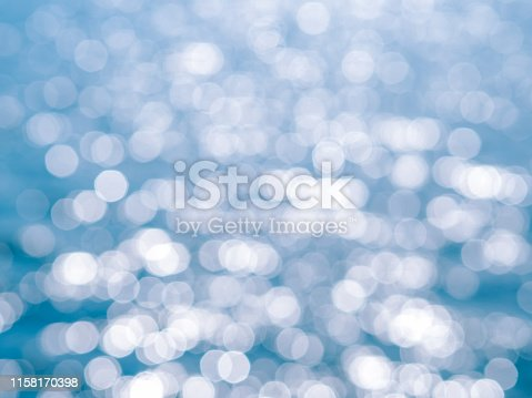 653331540 istock photo Abstract blue circles bokeh from nature for Christmas of any background 1158170398