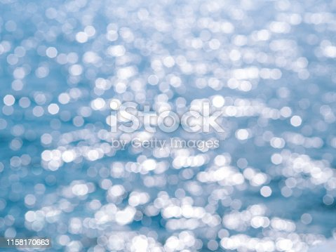 653331540 istock photo Abstract blue circles bokeh from nature for Christmas of any background 1158170663